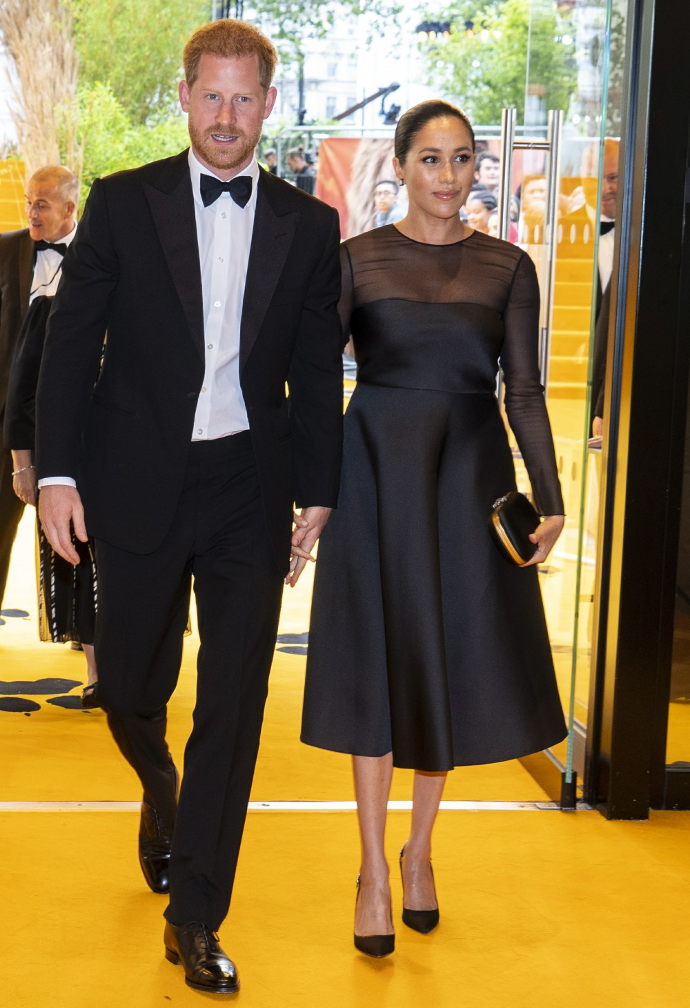Britain's Prince Harry, Duke of Sussex (L) and Britain's Meghan, Duchess of Sussex (R) arrive to attend the European premiere of the film The Lion King in London on July 14, 2019.