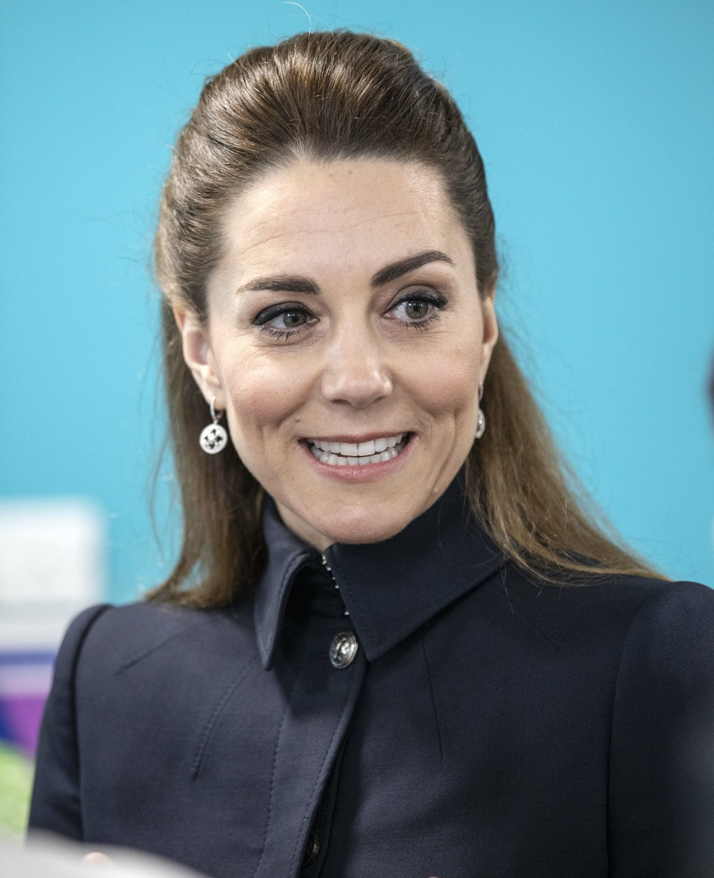 The Duchess of Cambridge talks to staff and patients during a visit to the defence medical rehabilit...