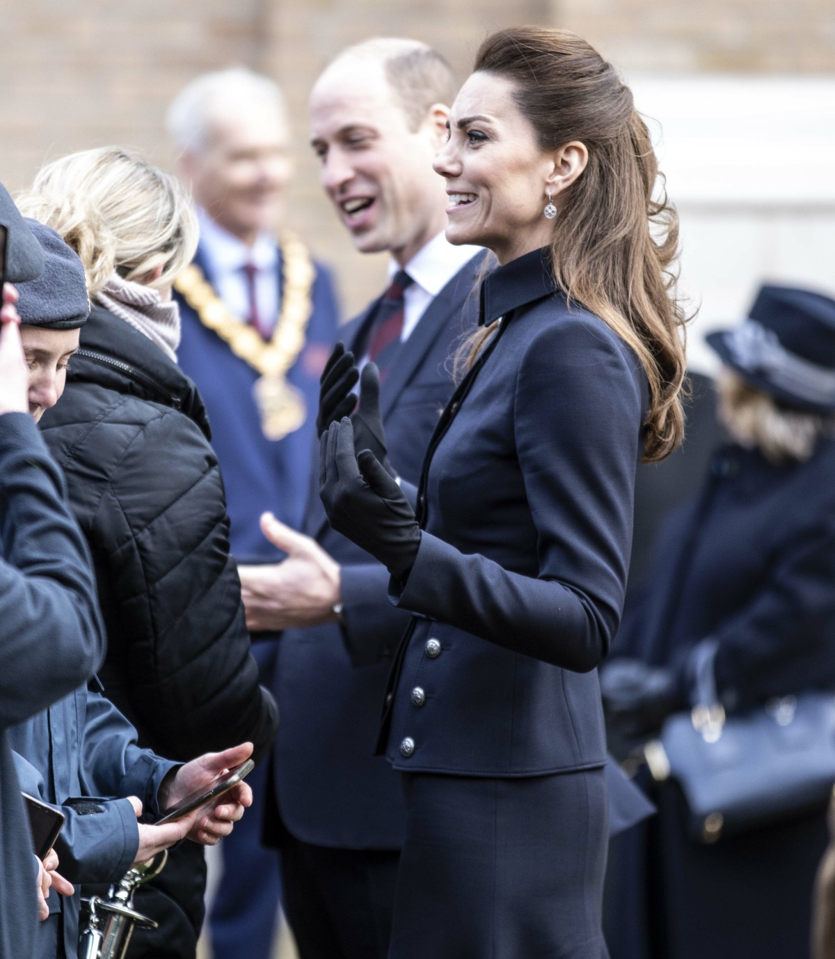The Duke and Duchess of Cambridge talk to staff and patients during a visit to the defence medical r...