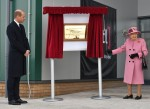 Britain's Prince William, Duke of Cambridge, (L) stands by as Britain's Queen Elizabeth II (R) unveils a plaque to officially open the new Energetics Analysis Centre at the Defence Science and Technology Laboratory (Dstl) at Porton Down science park near Salisbury, southern England, on October 15, 2020. - The Queen and the Duke of Cambridge visited the Defence Science and Technology Laboratory (Dstl) where they were to view displays of weaponry and tactics used in counter intelligence, a demonstration of a Forensic Explosives Investigation and meet staff who were involved in the Salisbury Novichok incident. Her Majesty and His Royal Highness also formally opened the new Energetics Analysis Centre.
