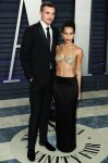 Karl Glusman and fiance/actress Zoe Kravitz arrive at the 2019 Vanity Fair Oscar Party held at the Wallis Annenberg Center for the Performing Arts on February 24, 2019 in Beverly Hills, Los Angeles, California, United States. (Photo by Xavier Collin/Image